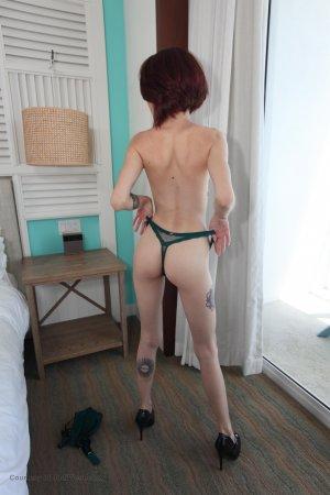 Lola Fae Teases In Her Green Lingerie Image